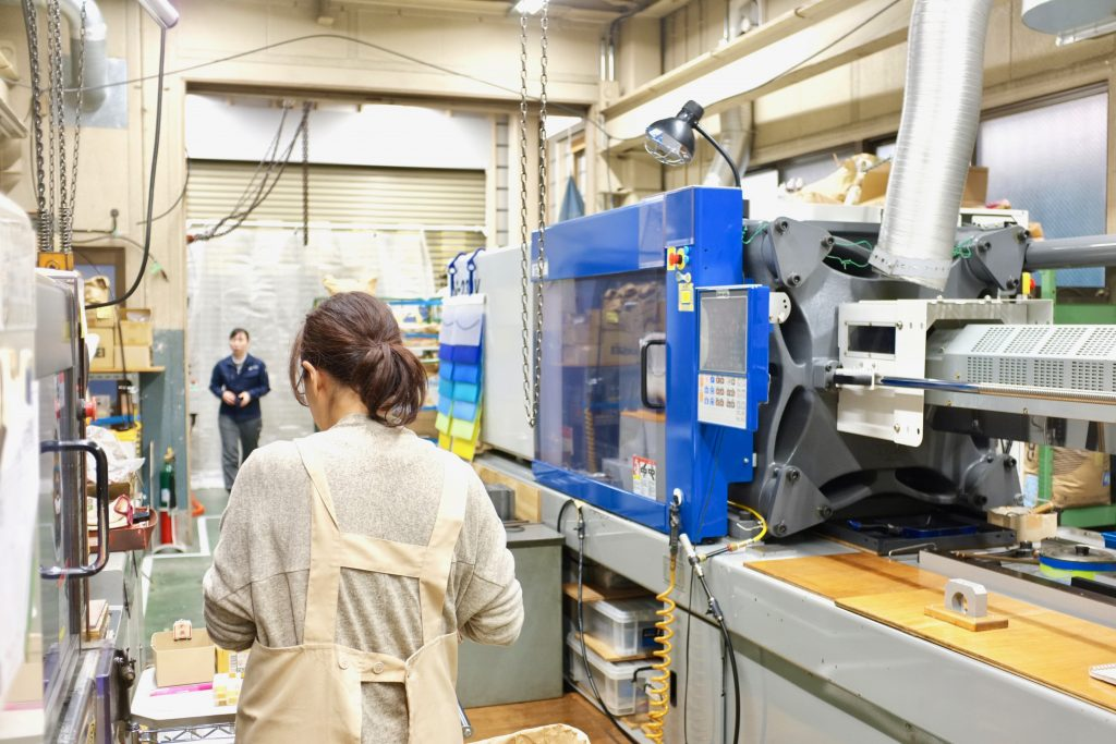 Photo: A staff working on an injection molding.